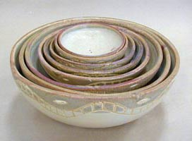 set of nine stoneware footed bowls with earth colors, juego de 9 jicaras en alta temperatura color tierra